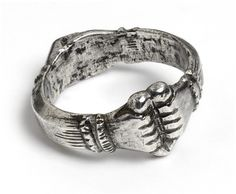 (CLOSE UP) Fede Ring. 1400, Italy. Made from silver, two hands clasping a heart are engraved from the metal. This ring would have been a present to show a person's promise of everlasting love and fidelity