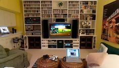http://www.versasolutions.com/wp-content/uploads/2012/04/game-room.jpg - Small pic but a very organized gaming room wall