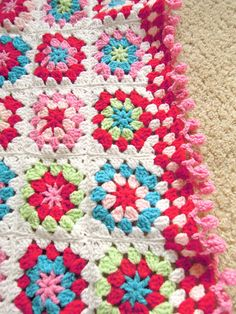 Gorgeous vibrant granny blanket made by Rachel of Ruby Red.