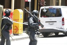 Officers from the Tactical Operations Unit of the New South Wales Police Force on 15/12/14, during the siege of a cafe in Sydney CBD[930x625]