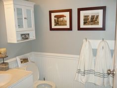 nautical bathroom - grey walls, white towels with navy stripes