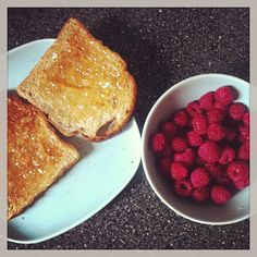 Healthy breakfast - bowl of raspberries and toast with Mackays marmalade.