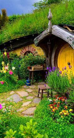 Hobbit House. If my front garden looked like this I'd just sit out and admire it alllllll day.