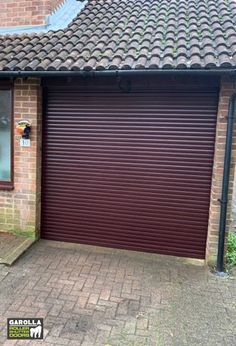 If you're wondering how much are garage doors, click the link to see our roller shutter garage doors cost. Garage Door Cost, Garage Door Decor, Garage Door Design, Garage Door Installation, Roller Shutters, Curb Appeal, Link, Outdoor Decor, Home Decor