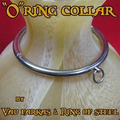 "Rolled steel collar w/ o-ring & allen screw ""lock"".  Available w/ inset gemstones.  $130"