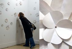 An olfactory installation of flowers constructed from magazine perfume ad scent strips in Wisconsin
