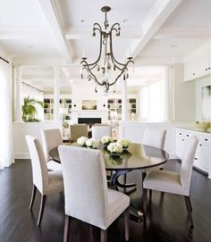 Note floors and wall color. I like the round dining table too. New Home with Comfortable Charm | Traditional Home