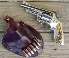 Smith & Wesson Model 29 .44 Magnum. - Beretta M9 Compact Custom wood Grips http://www.rgrips.com/en/beretta-92-96-compact-grips/97-beretta-92-96-compact-grips.html....  Protection from bears ?
