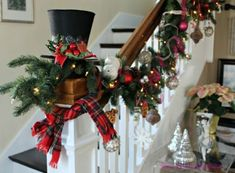 lush Christmas garland with ornaments, lights and plaid fabric