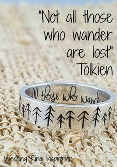 """Not all those who wander are lost"" - Tolkien. A simple silver ring with a hand drawn tree pattern on the exterior and ""Not all those who wander are lost"" engraved inside. aff"