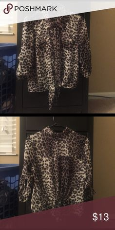 Mine Cheetah Print Blouse. Sheer cheetah print blouse. Blouse ties in front and has a super cute back. In great condition only worn a couple of times. Mine Tops Blouses
