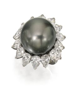 Platinum, Black Cultured Pearl and Diamond Ring, Van Cleef & Arpels, centered by a black cultured pearl measuring approximately 17.7 mm, framed by 16 pear-shaped diamonds weighing 8.27 carats, size 5¼, signed Van Cleef & Arpels, numbered N.Y.66401. With signed box.