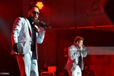 AJ McLean and Nick Carter perform with the Backstreet Boys at Bank of America Pavilion on August 12, 2013 in Boston, Massachusetts.