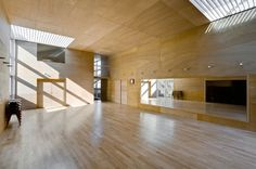 'hall and house' by fuminori nousaku architects    built for a dance instructor, this residence is composed of a large light-filled studio and small private residence.   a series of windows open on to both the dance hall and the corridors, allowing natural light to enter the home from multiple directions.