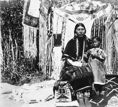 Cayuse/Chinook woman known as Ida Howlish or Te-Mow-E-Ne poses with child and many beaded objects :: American Indians of the Pacific Northwest -- Image Portion