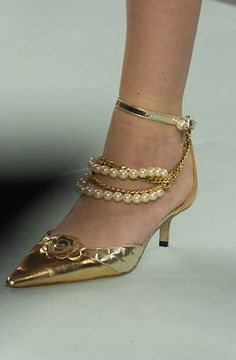 Chanel gold kitten heel pumps with pearls