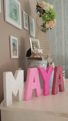 What you can do with some cardboard letters, paint and glitter!  Little girls name in lettets can use for bedroom or as photo prop! Ombre pink glitter letters