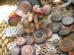 Saucer shaped paper beads