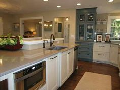 Using a pop of color in the kitchen is becoming a favorite, retro-style kitchen idea. These blue cabinets are a great touch to an otherwise white kitchen. Rustic Kitchen, Diy Kitchen, Kitchen Decor, Kitchen Ideas, Kitchen Counters, Kitchen Trends, Kitchen Islands, Open Kitchen, Kitchen Layout