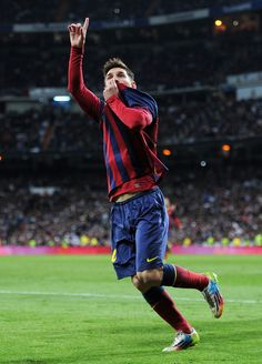 Lionel Messi of Barcelona celebrates scoring his team's fourth goal during the La Liga match between Real Madrid CF and FC Barcelona at the Bernabeu on March 23, 2014 in Madrid, Spain.