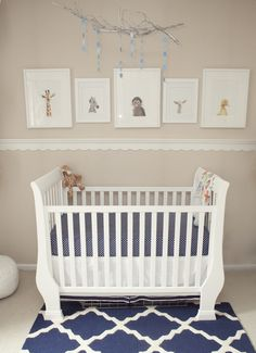 Such a cute nursery - love the scalloped detail on the wall!
