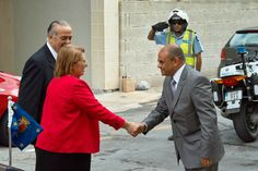 H.E. Marie Louise Coleiro Preca, President of Malta being greeted by Mr Anthony J. Tabone, Chairman of the Broadcasting Authority [left] and by Mr Pierre Cassar. CEO [right].