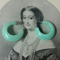 "Vintage sea foam green plastic hoop earrings Vintage sea foam green post earrings.  Measures about 1"". Lightweight and in good vintage condition. From the 1980s. Vintage Jewelry Earrings"