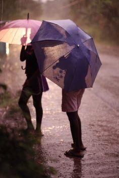 From sun to rain. This is the hurricane season in Haïti (Jacmel) Rain Umbrella, Under My Umbrella, Purple Umbrella, Walking In The Rain, Singing In The Rain, Rainy Night, Rainy Days, Arte Black, Smell Of Rain
