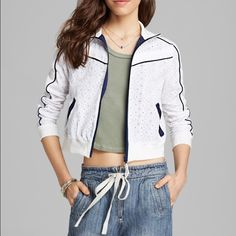 Free People Eyelet Track Jacket NWT. Free People Eyelet Track Jacket. Ivory color with navy blue stripe detail. Lightweight, cotton, zips up. Perfect for seasonal transitioning. Free People Jackets & Coats