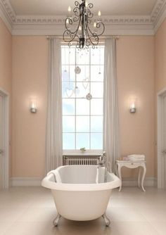 Chandelier #lighting adds an extra pretty touch to this claw foot tub.