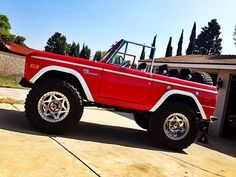 "Classic early ford bronco 20"" wheels with 40"" tires Topless red"