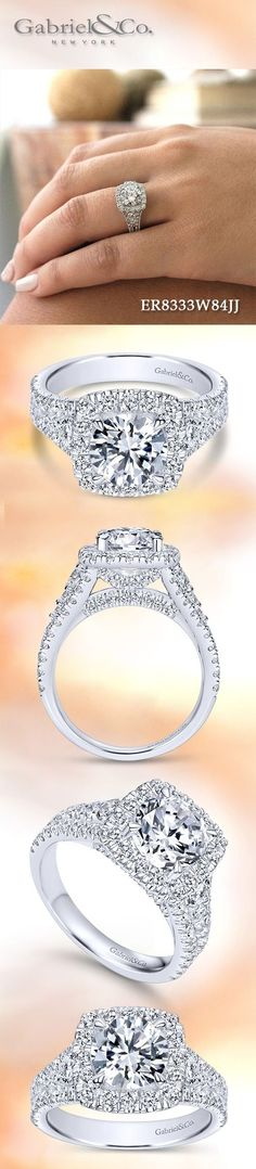 Gabriel NY - Preferred Fine Jewelry and Bridal Brand. 18k White Gold Round Halo engagement ring. In this magnificent halo engagement ring, diamond side stones accompany a pave diamond split shank band. Additional diamonds add unexpected sparkle to the gallery.  Find your nearest retailer-> https://www.gabrielny.com/storelocator
