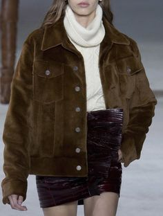 skirt, beige white turtleneck sweater, brown jacket