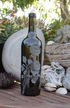 Roses Design is carved / sandblasted onto empty wine bottles, and transformed into either oil lamps or olive oil dispensers. A 12 stage multi- carved design is applied onto this thick glass bottle that weighs 6 lbs. Empty Wine Bottles, Wine Bottle Candles, Glass Bottles, Bottle Art, Bottle Crafts, My Glass, Glass Art, Olive Oil Dispenser, Pewter Art