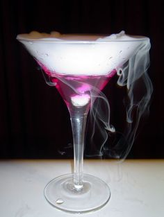 Halloween Cocktail :: Color Changing Martini -- This drink smokes elegantly, changes from a calm blue to fuschia as it cools from room temperature to drinkably cold, and tastes like a dirty martini. Party Drinks, Cocktail Drinks, Fun Drinks, Yummy Drinks, Alcoholic Drinks, Cocktail Ideas, Refreshing Drinks, Dry Ice Cocktails, Sweet Cocktails