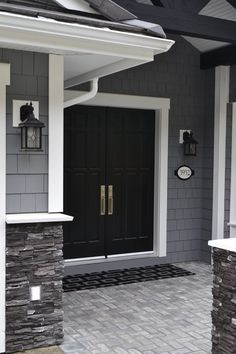 Granite Grey shingle siding with black door and white accents
