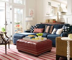 Family-Friendly Palette  Family-Friendly Palette  Adding color to a room doesn't have to involve paint. This navy blue couch creates a cozy backdrop for fun patterns, textures, and bold pops of red. The couch does what a good pair of jeans does for an outfit: creates a casual, yet composed look, which in this room yields a space that's perfect for family time.