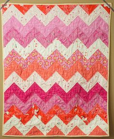 Zig Zag Baby Quilt, directions can be found at:  http://aquiltisnice.blogspot.com/2008/09/zig-zag-quilt-kit-tutorial.html