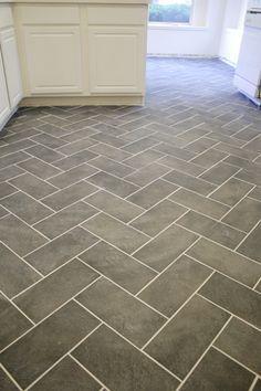 Herringbone porcelain tiles for the floor