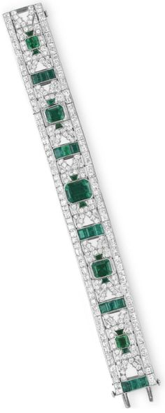 Art Deco diamond and emerald bracelet by Oscar Heyman & Brothers. Designed as a pierced circular-cut diamond band, set with a graduated series of cut-cornered rectangular-cut emeralds, spaced by columns of smaller rectangular-cut emeralds, decorated with trapeze-cut emerald detail and square-cut diamond trim, mounted in platinum, circa 1920, 7 1/8 ins. With maker's marks for Oscar Heyman & Brothers. Via Christie's.