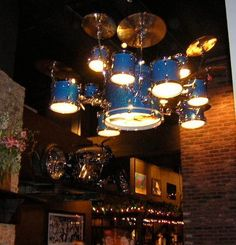 Drum Lights at HardRock Chandelier Old drums recycled as lights how cool!