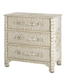 """Marchmont Chest of Drawers Wide coral-shaped drawer pulls, flowers constructed from almond-shaped shells, edges beaded with large scallops -  embodies high drama and classic whimsy for beach houses, feminine guest rooms, worldly spaces, and eclectic designs of all kinds. The thousands of white shells that mosaic the surface are a fresh yet timeless mode of adornment. H:32"""" W:33"""" D:20"""" $2,120.00"""