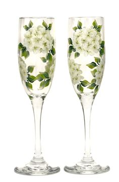 Creamy white hydrangeas encircling (2) quality 6 ounce champagne flutes. Perfect for wedding, shower & anniversary gifts. Many other flowers and color combinations, as well as bride & groom name/date