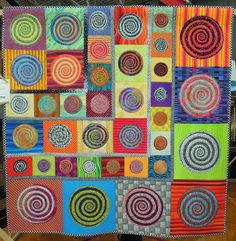 "Swirls 'n Whirls, 56 x 56"", by Ginny Lee.  2013 DVQG, photo by Quilt Inspiration"