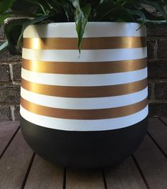Hand-painted lightweight plant pot in black and white with rose gold metallic stripes. This is a striking design which will add a touch a glamour to your home! The material of the pot is fibreglass and are painted using water-based paint.  Size is 25 x 25cm Medium - 35 x 35cm Large - 45 x 45cm  As the pots are hand painted they are delicate and need to be handled with care. They are intended for indoor use or in a covered outdoor area. Plants should be removed from the pot for watering.  The…