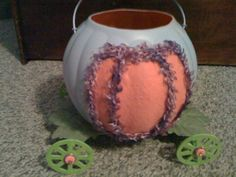 My daughter's Cinderella pumpkin coach for Trick or Treating (painted and trimmed a standard pumpkin bucket)