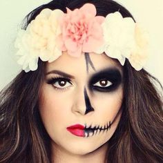 Half skull Halloween makeup with a big flower crown. Love it!