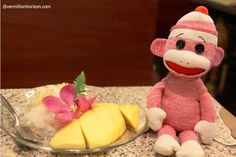 Lil' Squirt loves nothing better in Thailand than mangoes and sticky rice (Bangkok, Thailand)