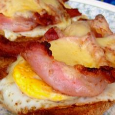 This mornings breakfast. • Egg • Bacon • Cheese Toasties  Delicious