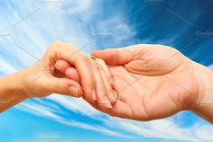 Two hands touching each other. People Photos